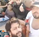 A still image taken on July 20, 2016 from an undated video posted on social media shows a boy before he was beheaded, on the back of a truck being taunted by rebel fighters in what is said to be Syria. Social MediaATTENTION EDITORS - THIS IMAGE WAS PROVIDED BY A THIRD PARTY. EDITORIAL USE ONLY. NO RESALES. NO ARCHIVE. REUTERS IS UNABLE TO INDEPENDENTLY VERIFY THIS IMAGE. ORG XMIT: SYR16